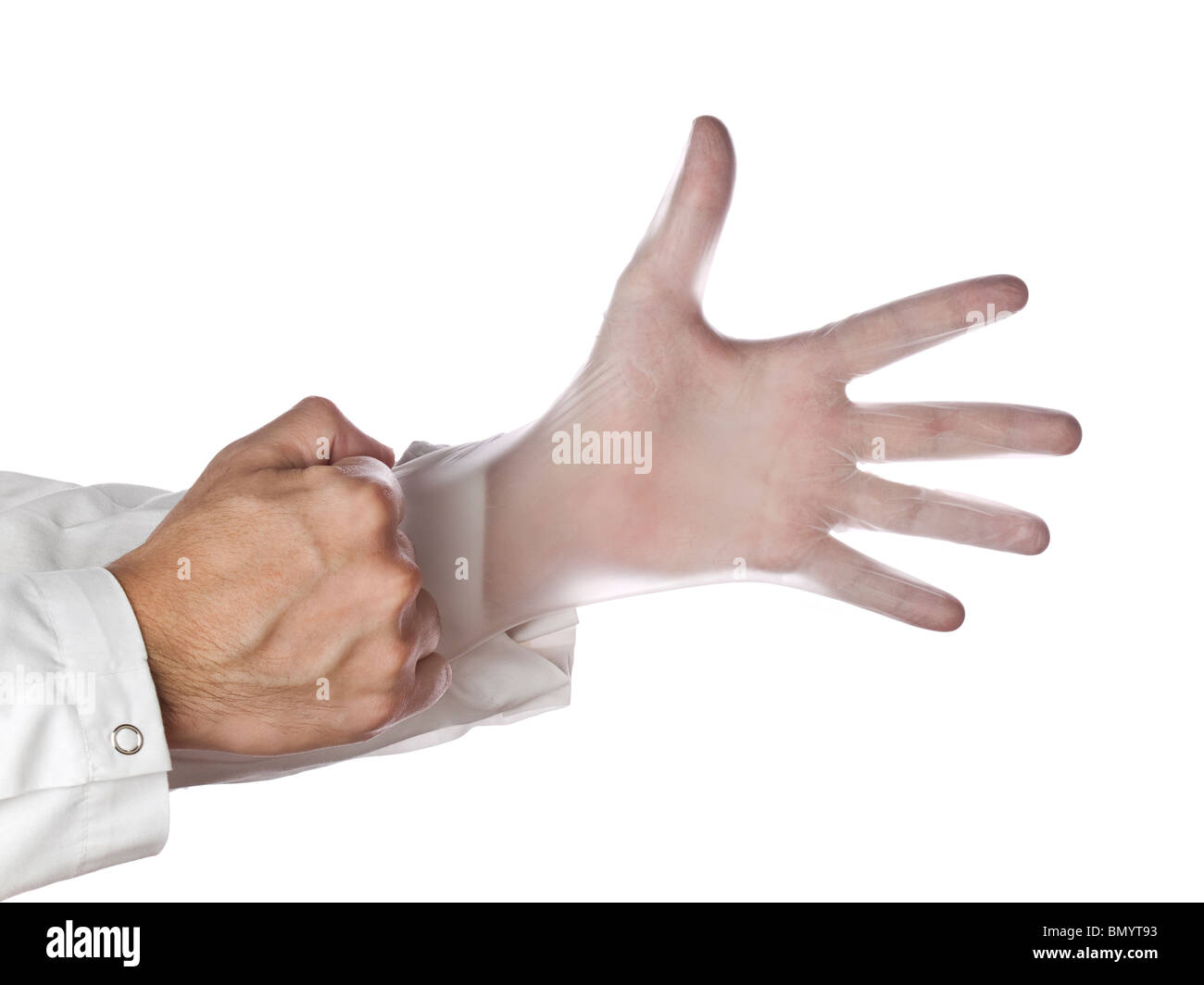 A doctor is putting on surgical latex gloves. - Stock Image