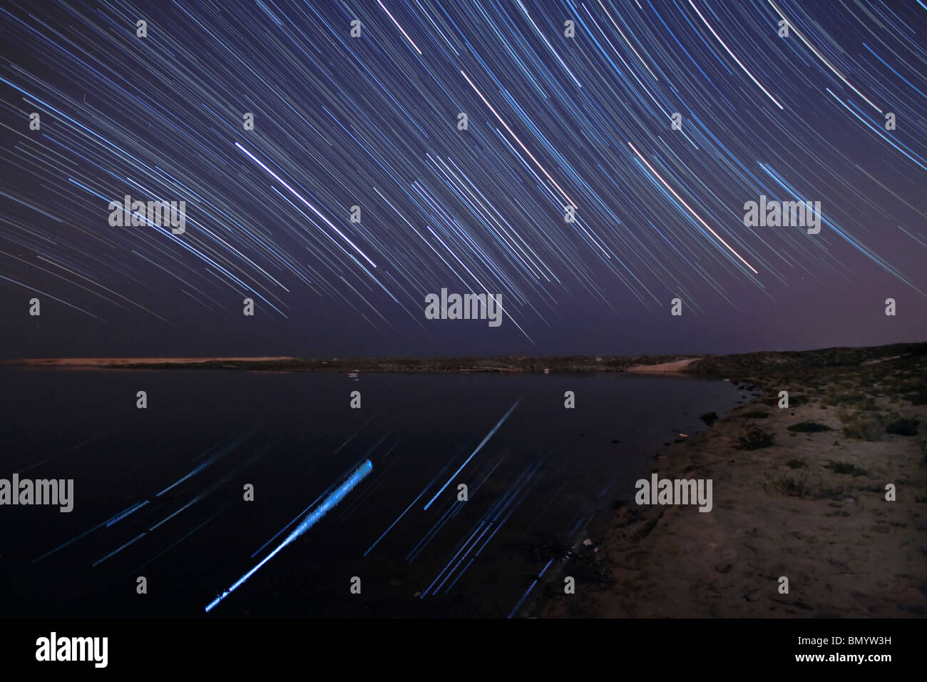 Star trails in the Albufeira Lagoon, Portugal. - Stock Image
