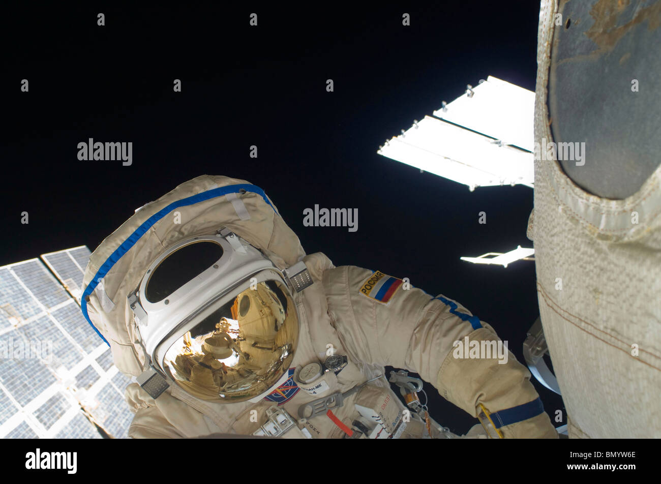 Russian cosmonaut performs a spacewalk. - Stock Image