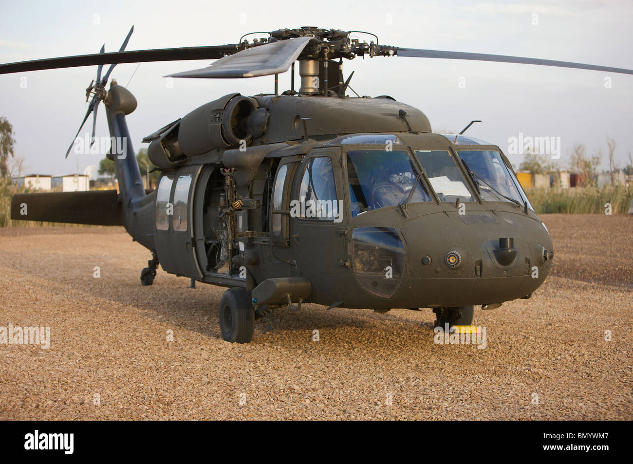 A UH-60L Black Hawk with twin M240G machine guns at the Victory Base Complex in Baghdad, Iraq. - Stock Image