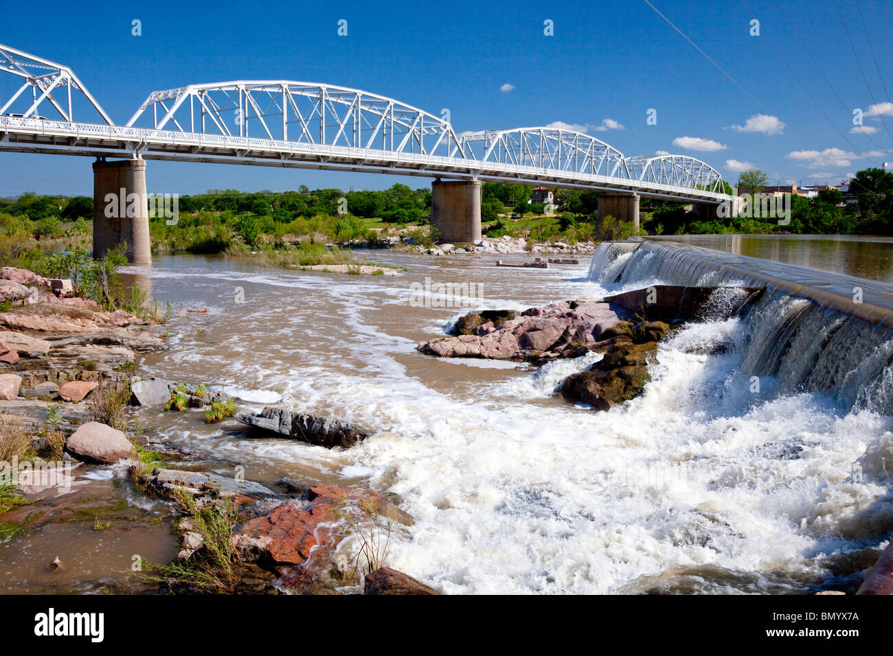 A bridge, dam and waterfall on the Llano river, Llano, Texas, USA. - Stock Image