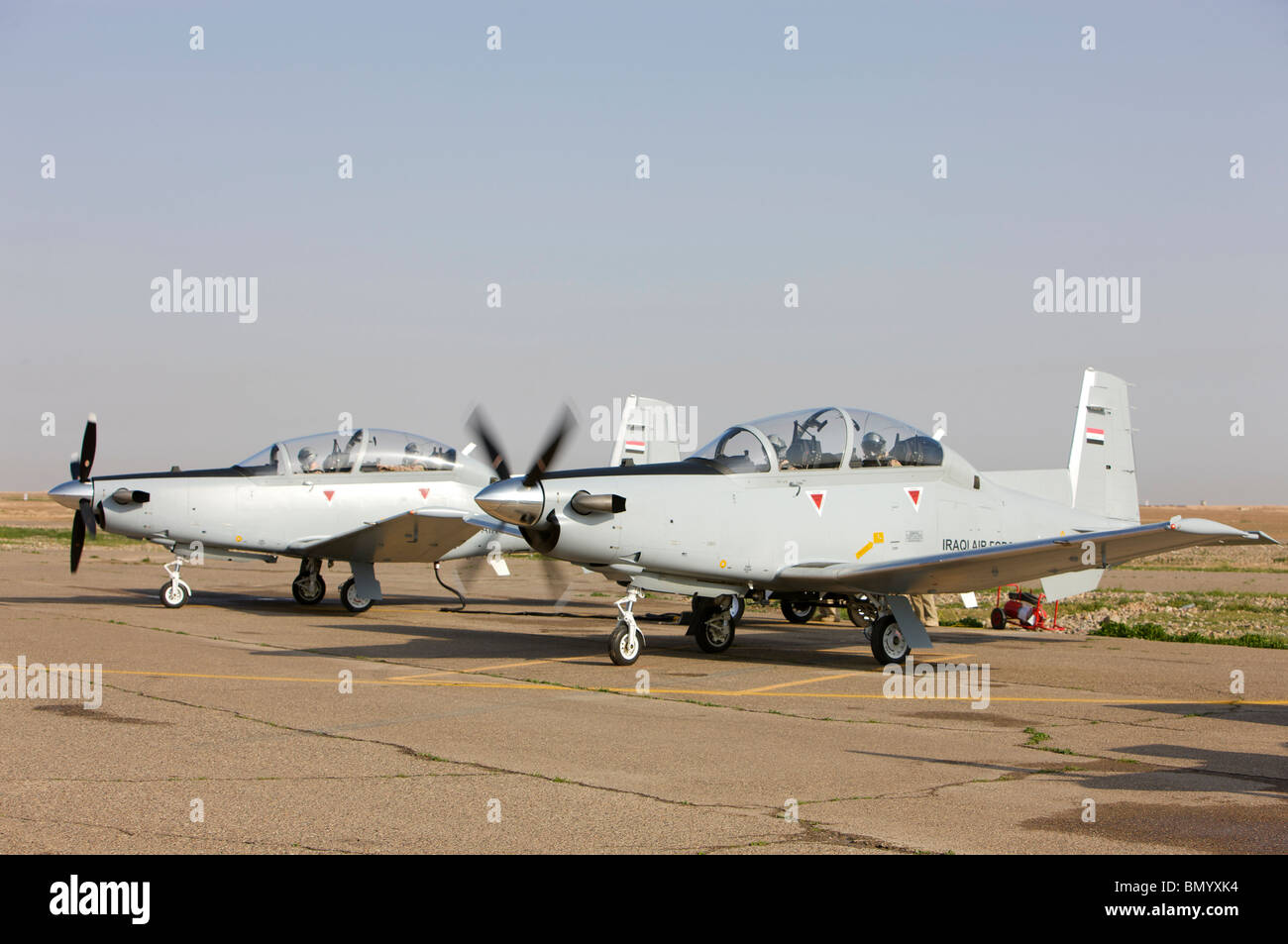 Pilots perform a pre-flight on their T-6 Texan trainer aircraft. - Stock Image
