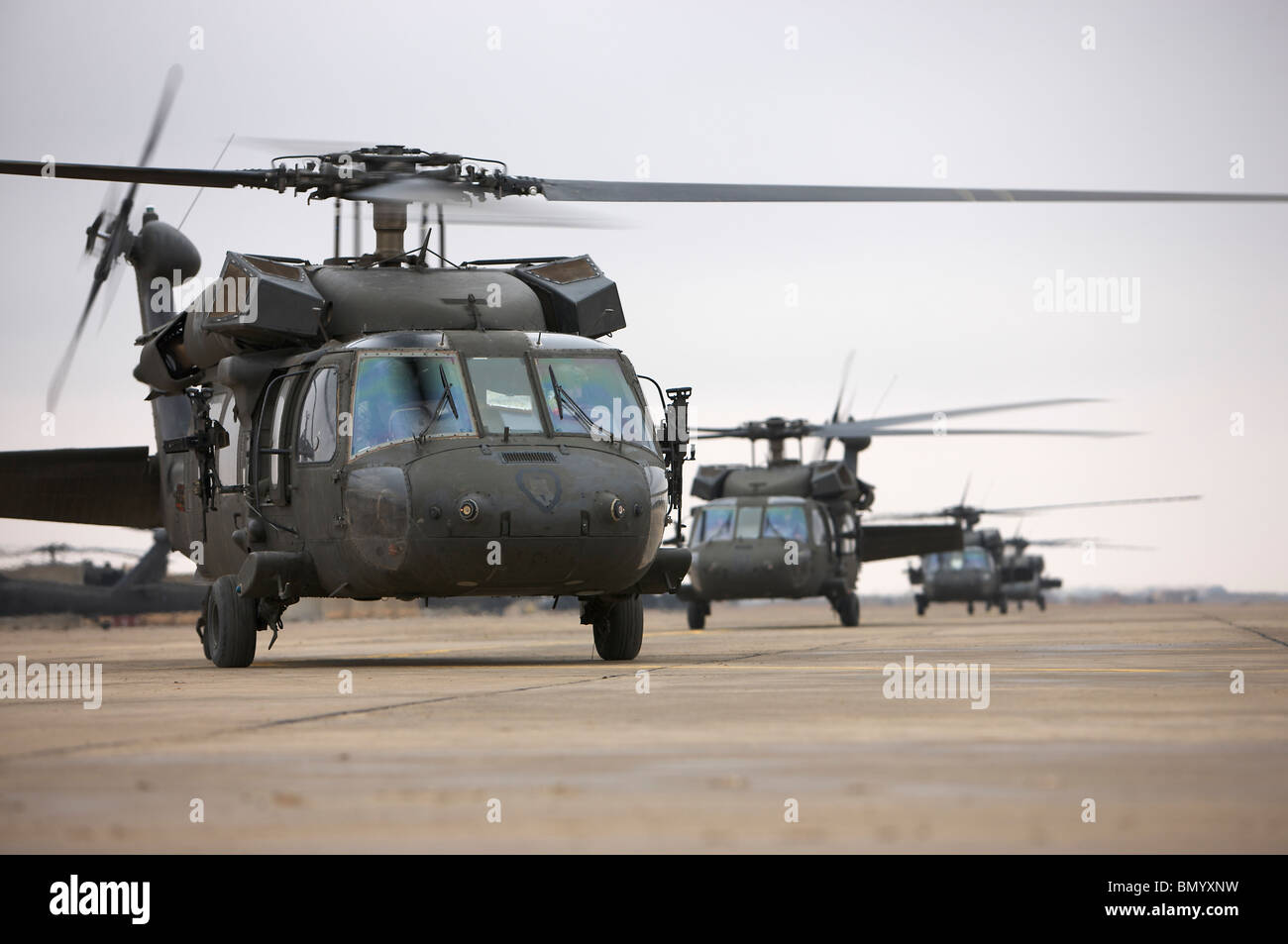 UH-60 Black Hawks taxi out for a mission over northern Iraq. - Stock Image