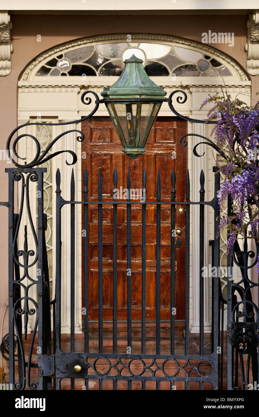 Gas Lamp Wrought Iron Gate And Wysteria In Front Of