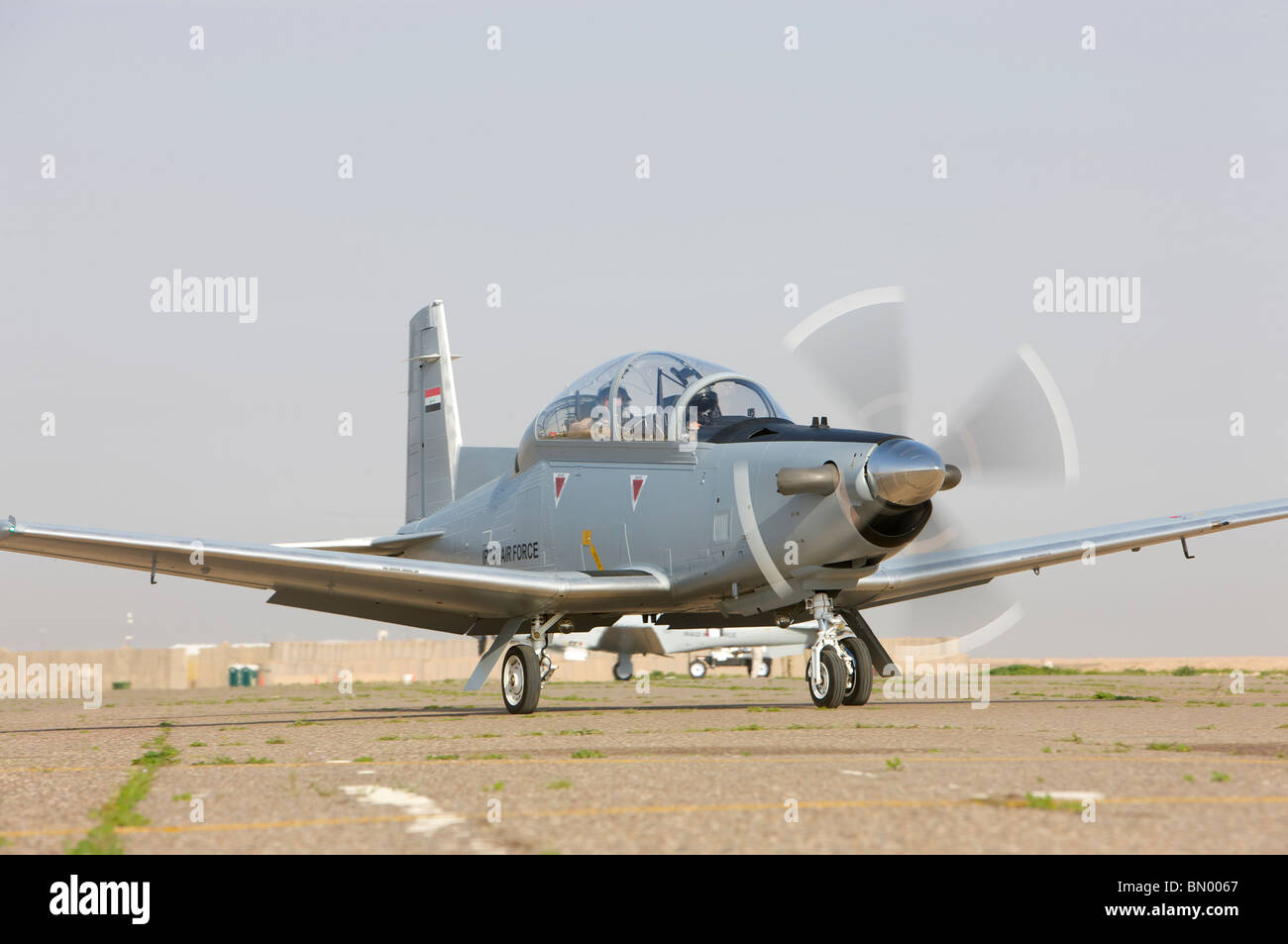 Pilots perform a pre-flight test on their T-6 Texan trainer aircraft. - Stock Image