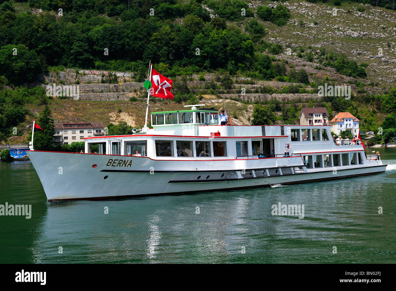 The Swiss lake cruiser Berna setting out from the port at Biel (Bienne) on the Lac de Biel (Bielersee), the captain - Stock Image