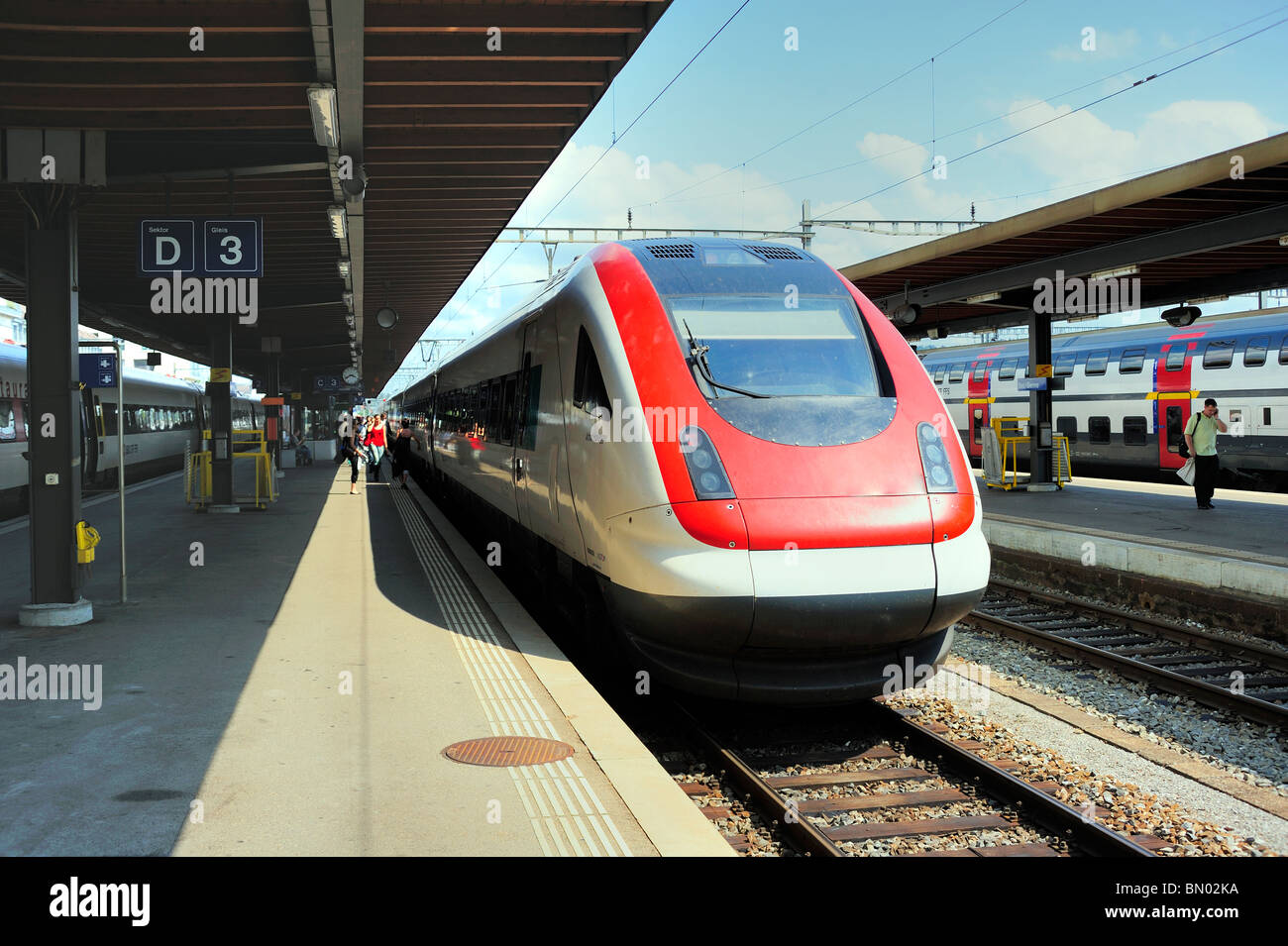 The railway station at Biel (Bienne), Switzerland, with an intercity train waiting at the platform - Stock Image