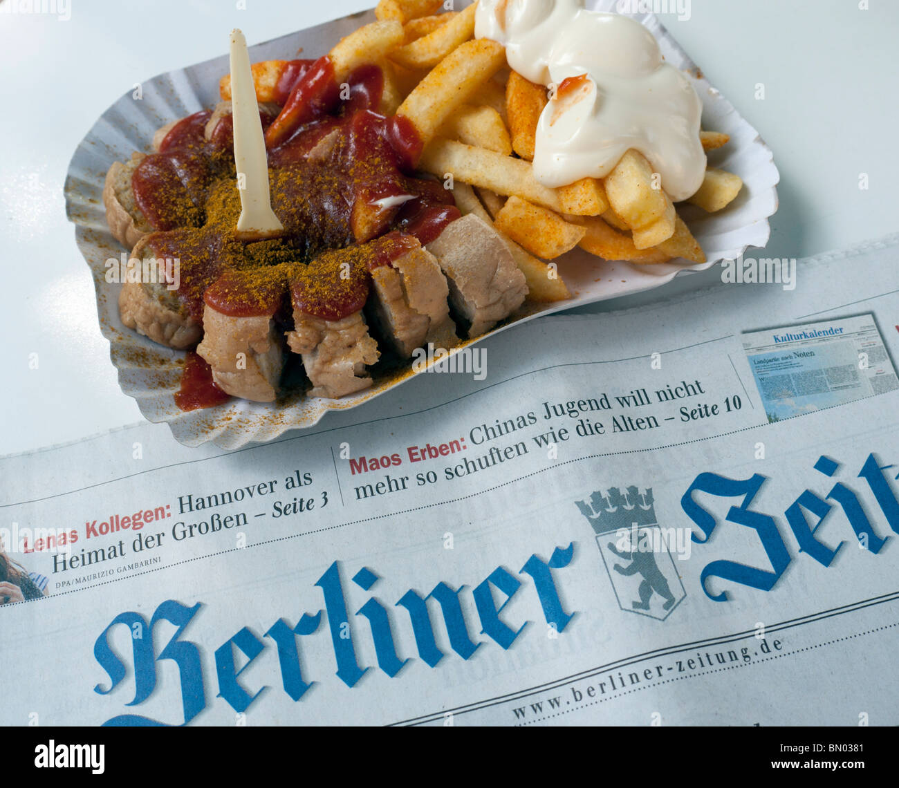 Detail of traditional Berlin currywurst snack at famous Konnopke`s currywurst stall in Prenzlauer Berg in Berlin - Stock Image