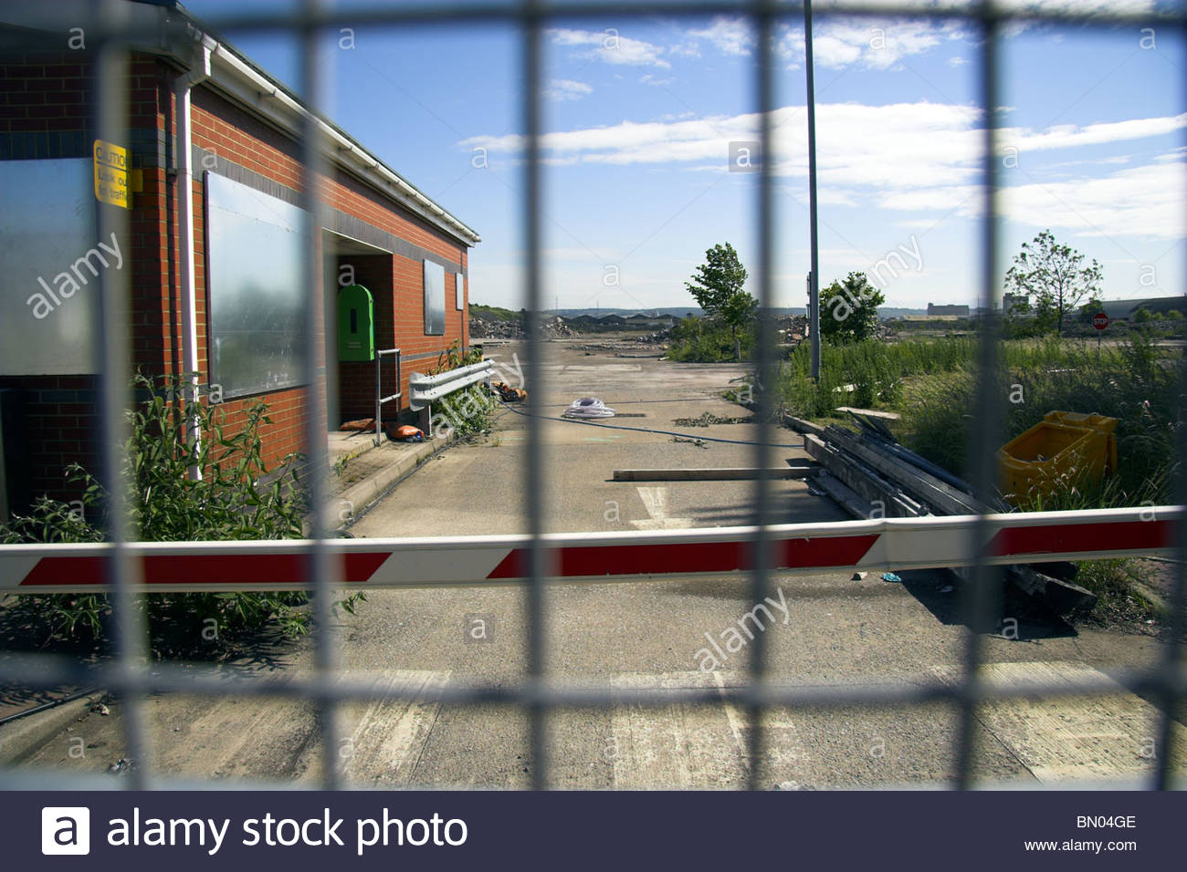 Securtity gate to the now derelict and demolished former Rhodia chemical plant in Avonmouth, Bristol, UK. - Stock Image