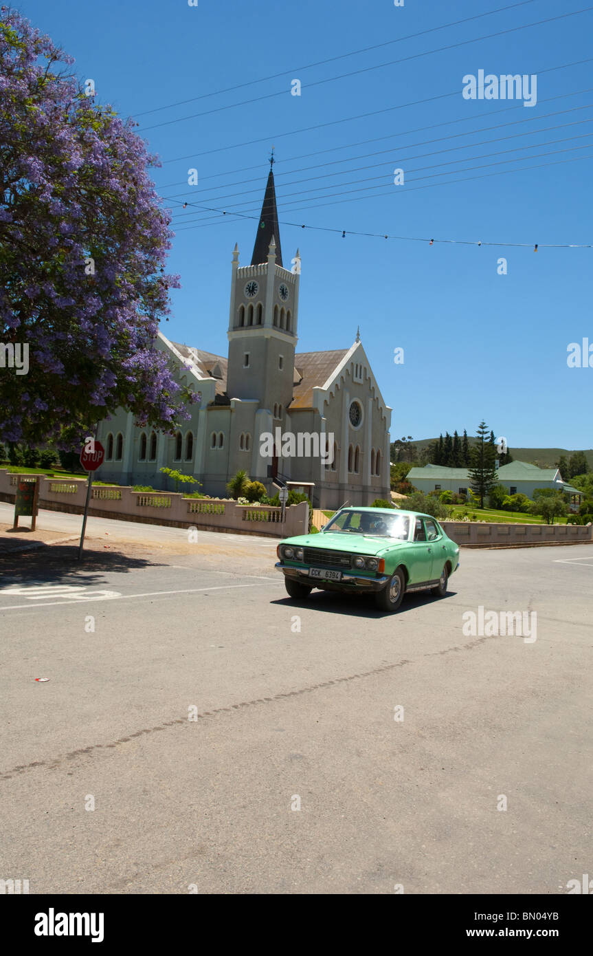 Old car being driven through the village of Barrydale in the Klein Karoo, Western Cape, South Africa, odd the R62 - Stock Image