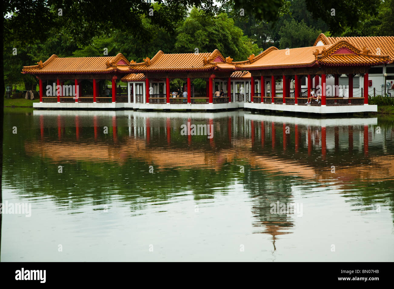 Singapore Chinese Garden's main asset is its integration of architecture with its natural  environment. - Stock Image