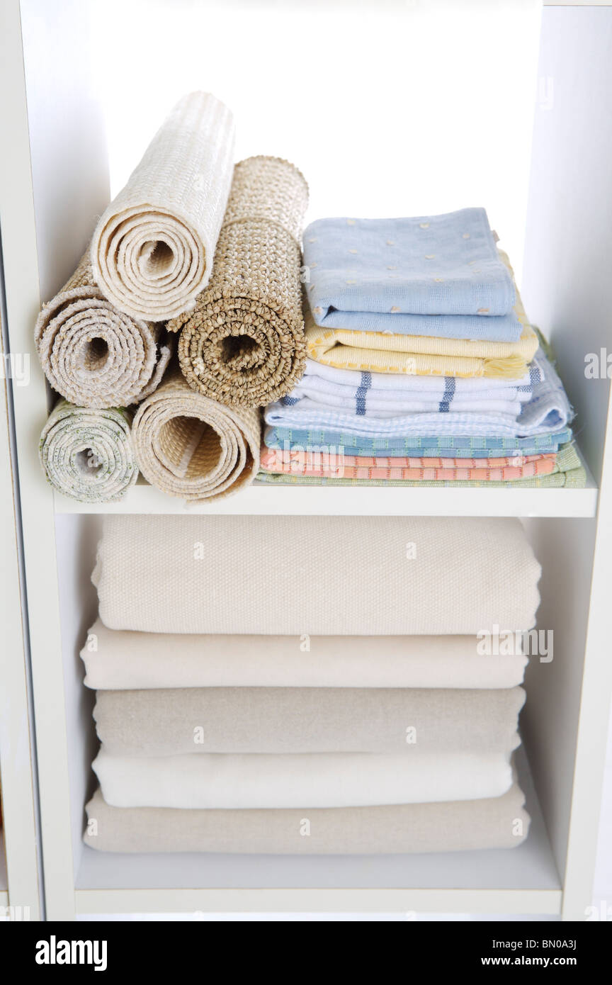 Clothes Rugs Stocked In A Closet Stock Photo 30126086 Alamy