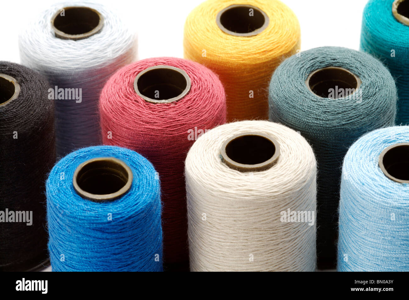 Spools of thread, full frame - Stock Image