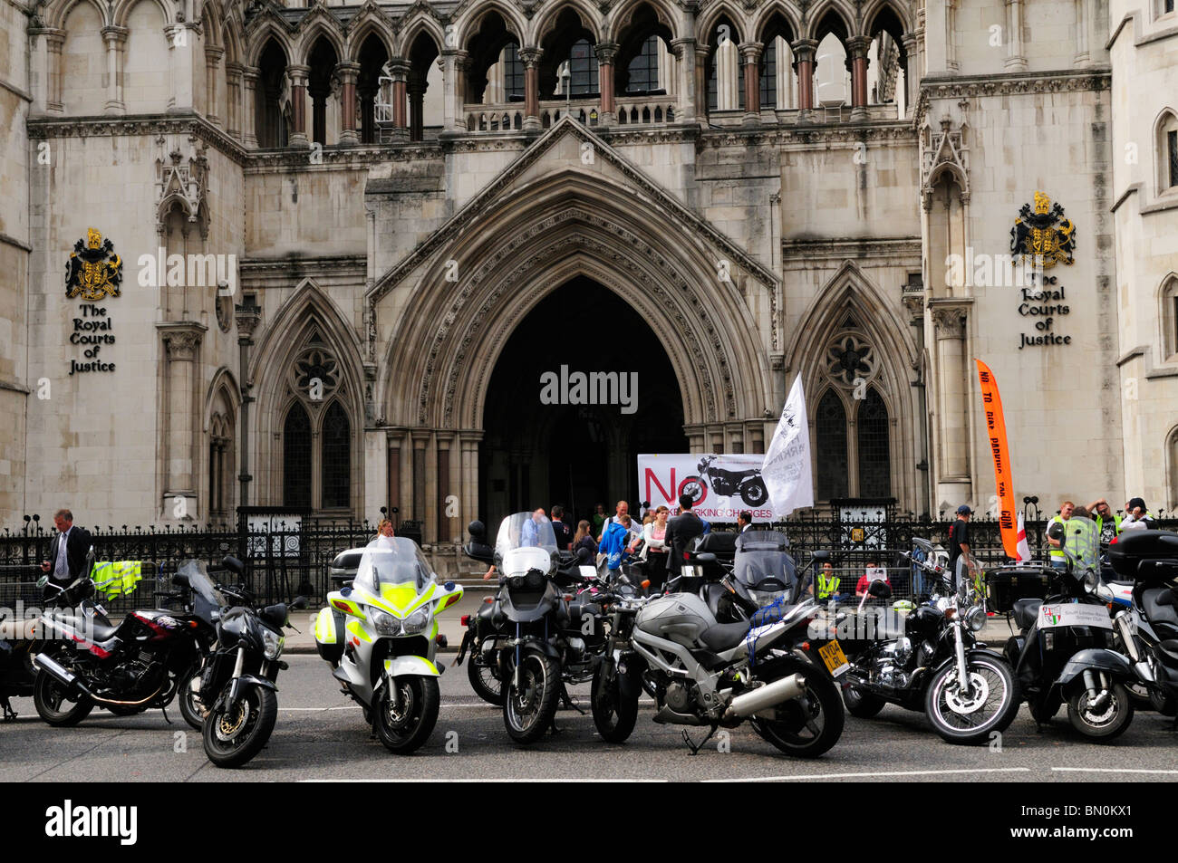 Protest against motorbike parking charges outside The Royal Courts of Justice, The Strand, London, England, UK - Stock Image