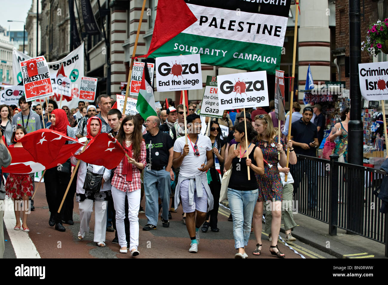 Participants march during a  demonstration against the Israeli blockade of Gaza in 2010 - Stock Image