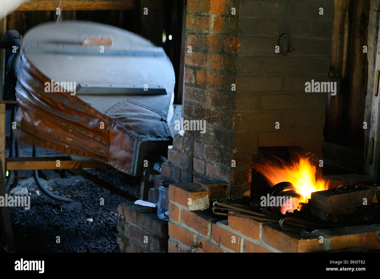 Historic Blacksmith shop bellows and forge furnace at Lang Pioneer Village Keene Ontario - Stock Image