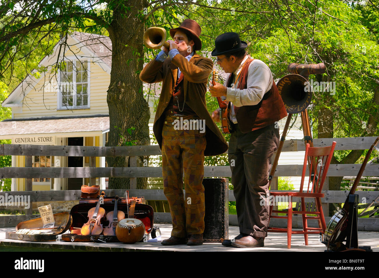 Musicians performing on antique musical instruments at Lang Pioneer Village Keene Ontario - Stock Image