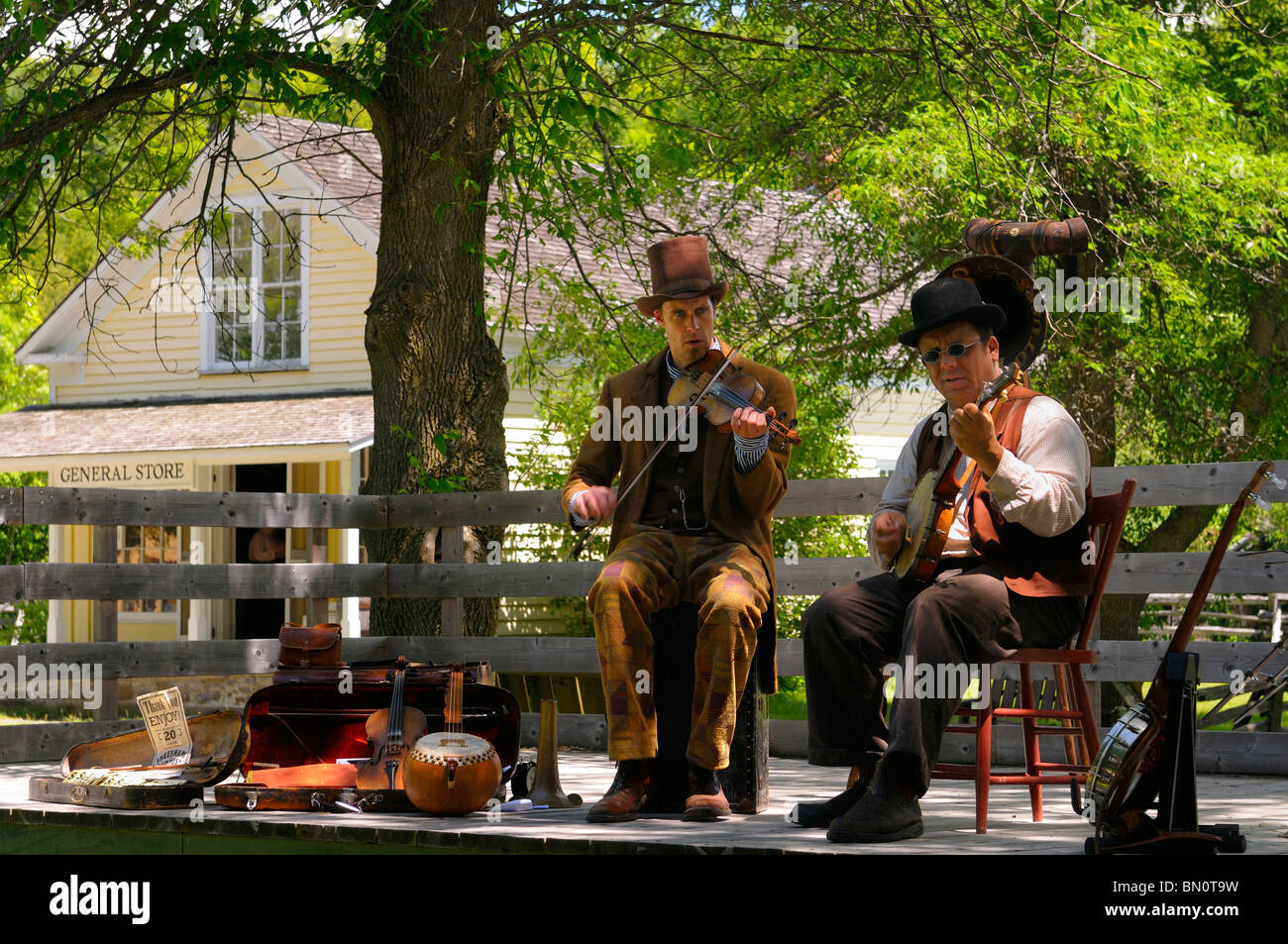 Fiddle and banjo players performing old time country music at Lang Pioneer Village Keene Ontario - Stock Image