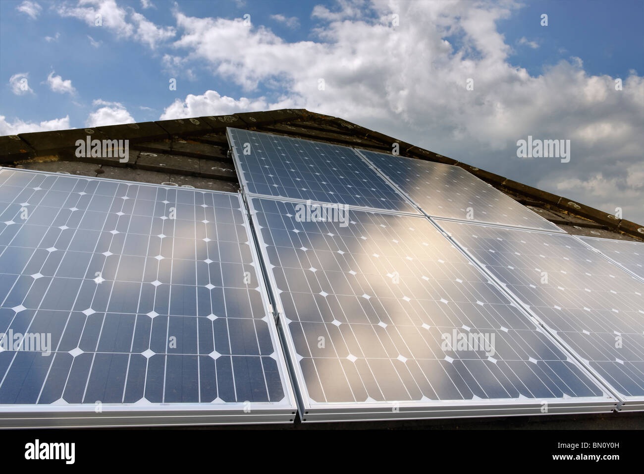 Solar Power. Photovoltaic cells on a domestic house roof in the UK - Stock Image