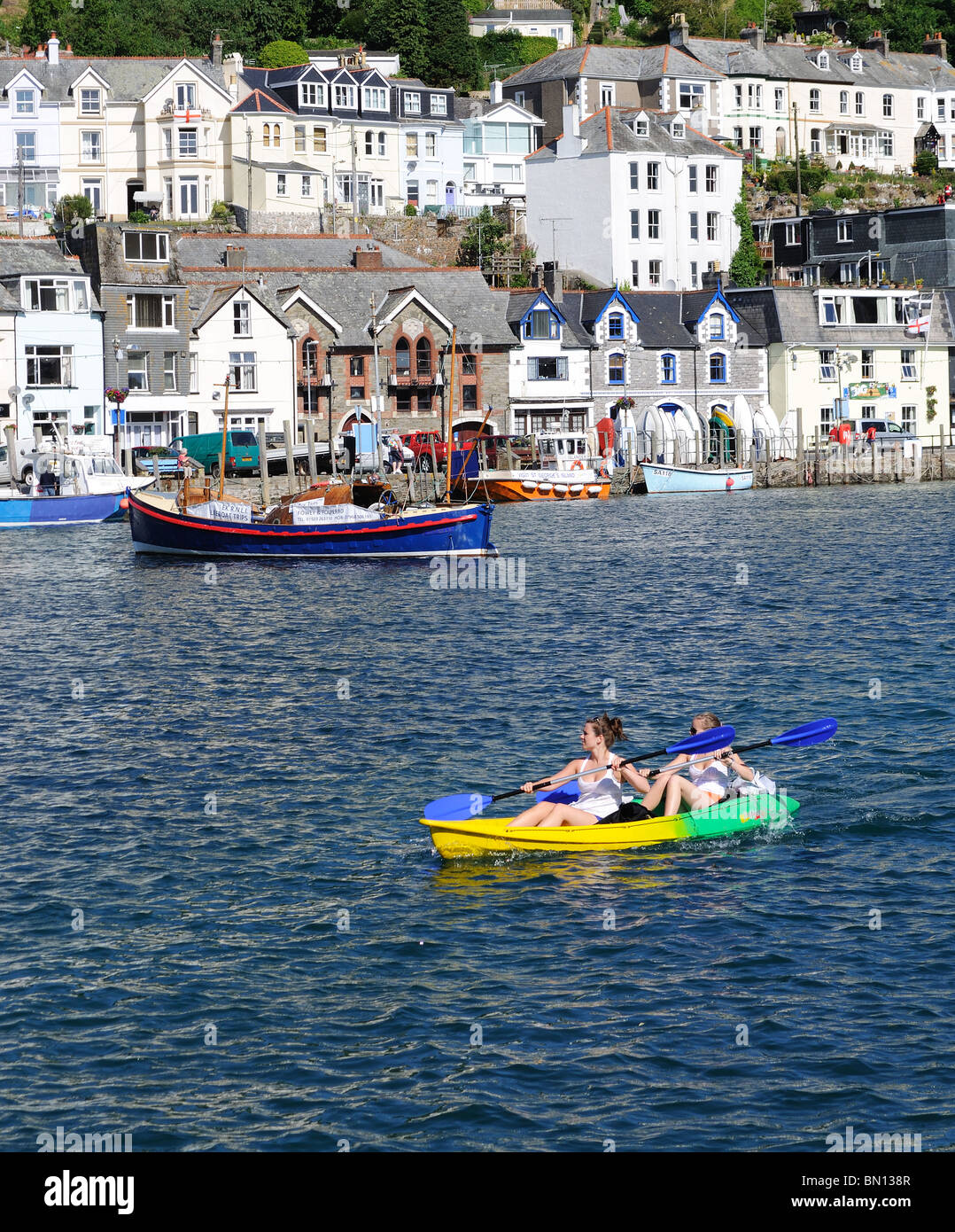 a canoe on the river at looe in cornwall, uk - Stock Image