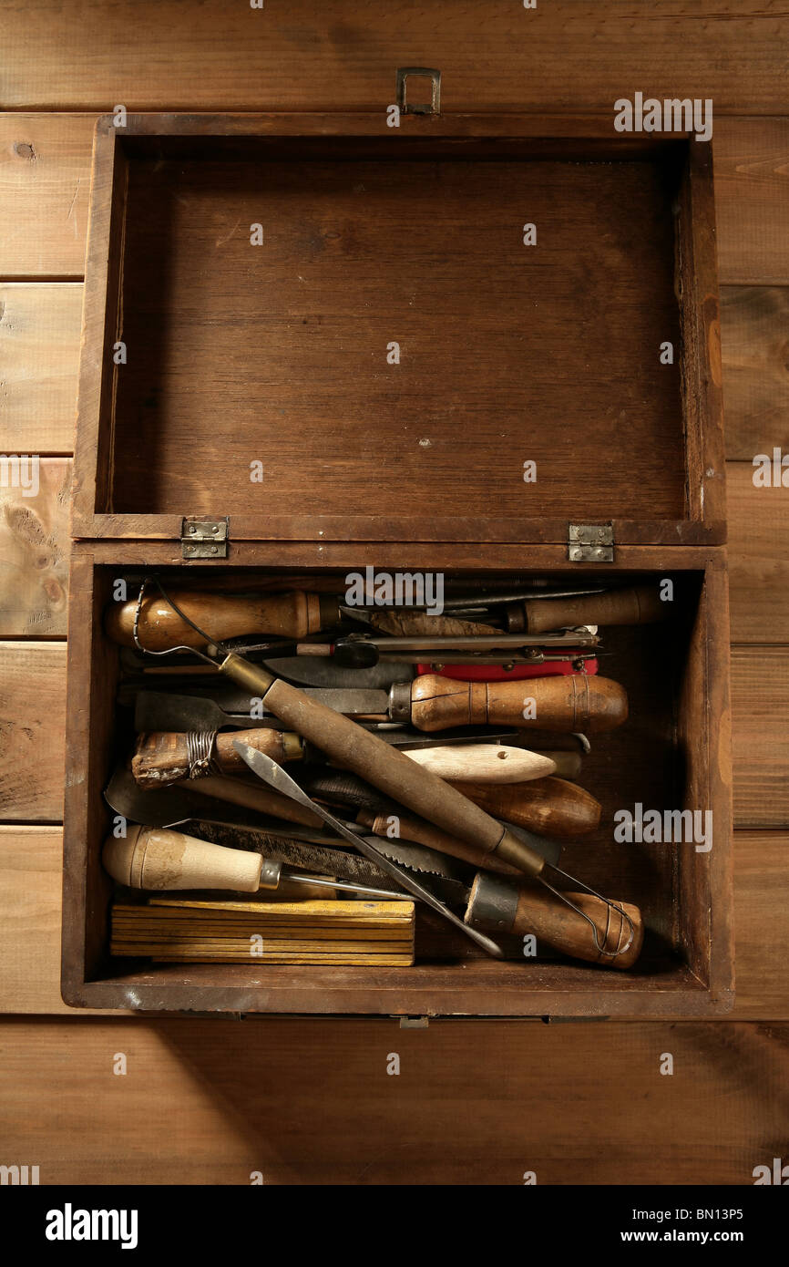 artist hand tools for handcraft works on golden wood background - Stock Image