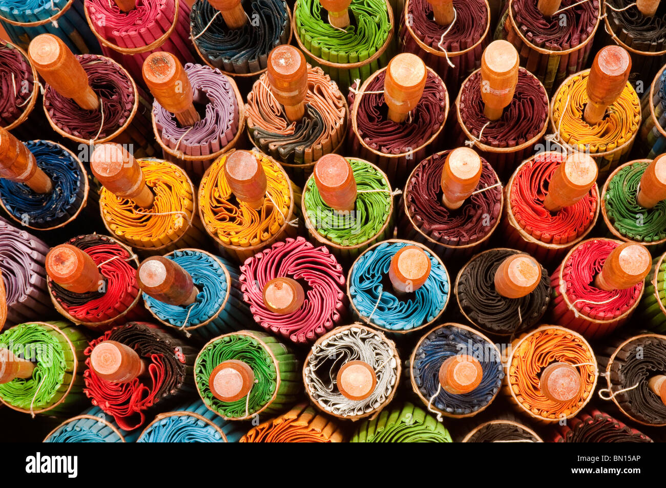 Rolled up umbrellas at The Umbrella Factory in Chiang Mai, Thailand. - Stock Image
