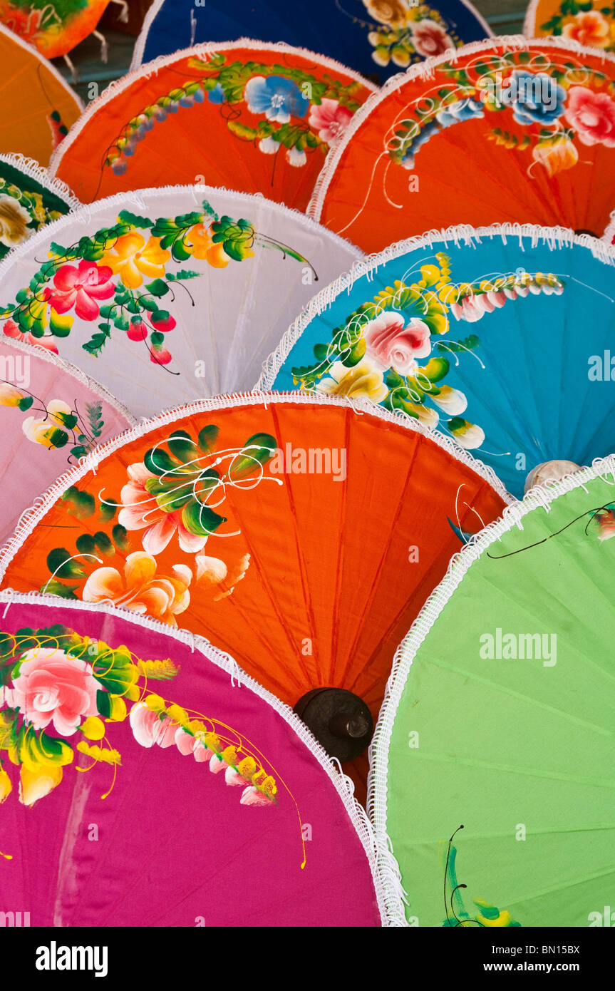 Hand-painted umpbrellas for sale at store in Chiang Mai, Thailand. - Stock Image