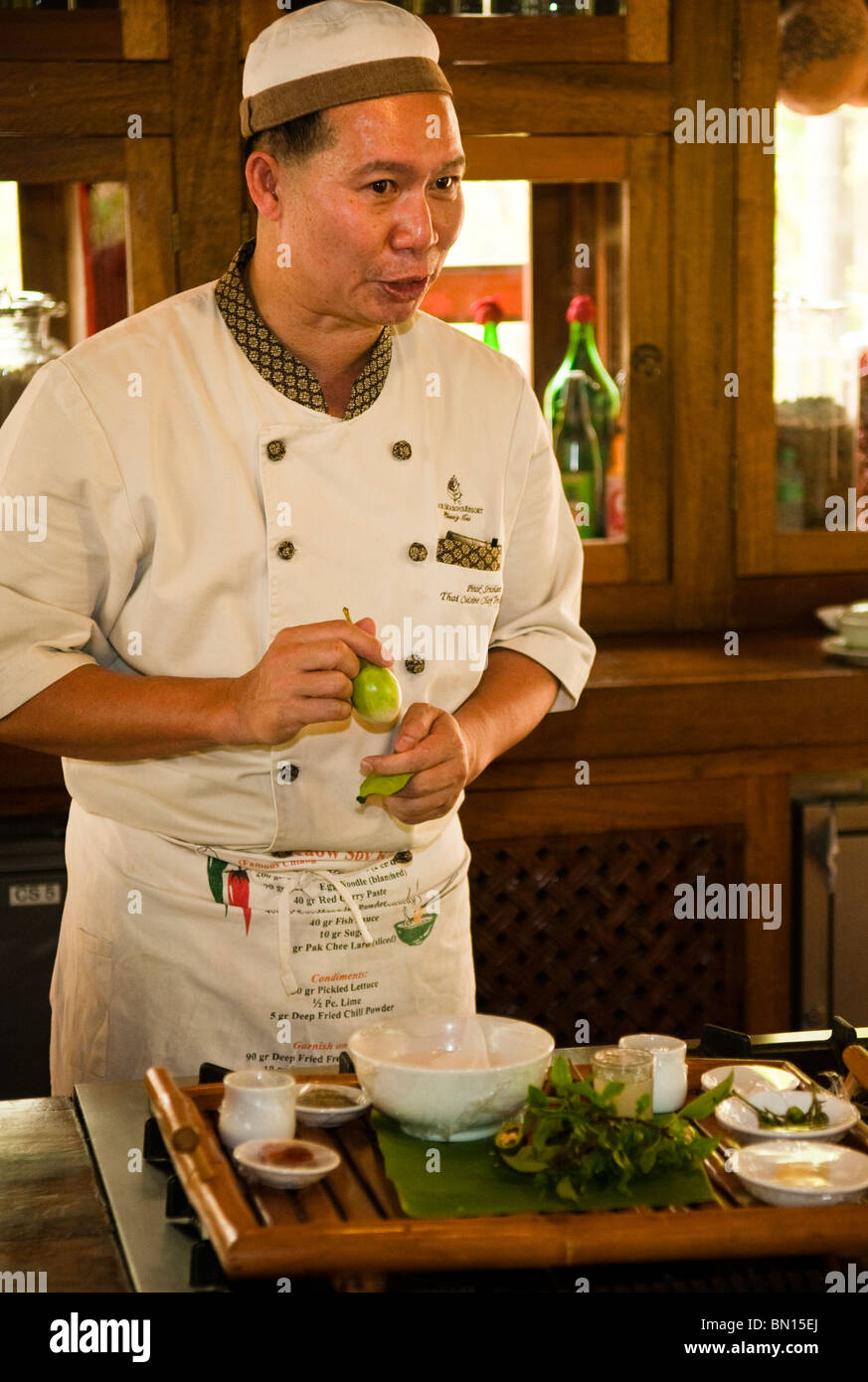 Chef Srichan Pitak leads the Thai cooking class at Four Seasons Resort in Chiang Mai, Thailand. - Stock Image