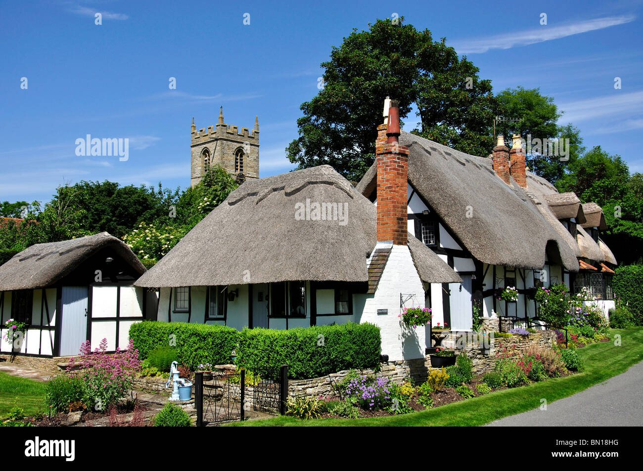 Thatched cottages and Church tower, Welford-on-Avon, Warwickshire, England, United Kingdom - Stock Image