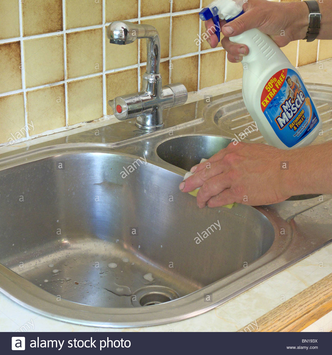 Man Cleaning Stainless Steel Kitchen Sink MODEL RELEASED Stock Photo ...