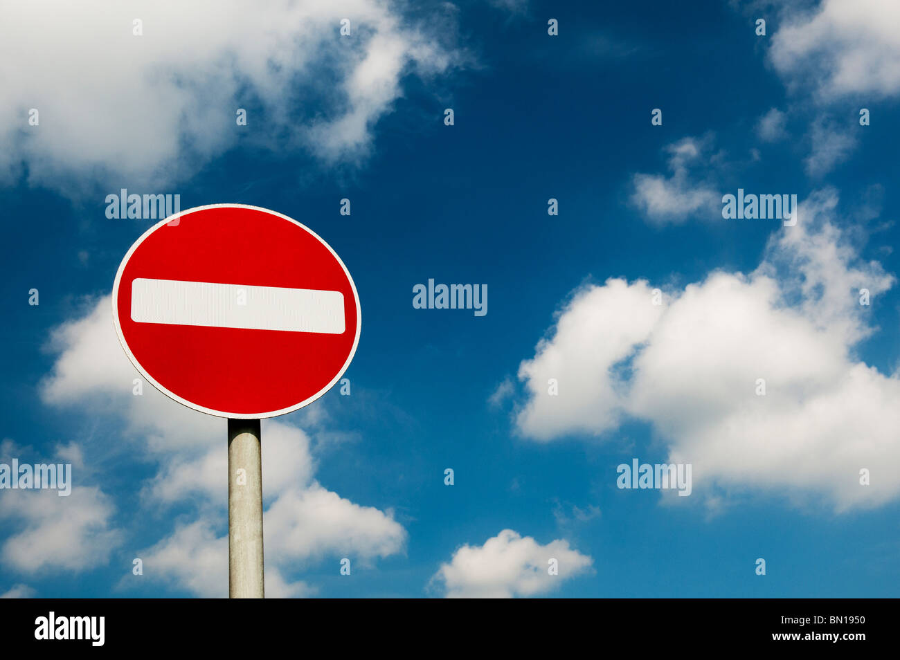 No entry road signpost against a cloudy blue sky. UK Stock Photo