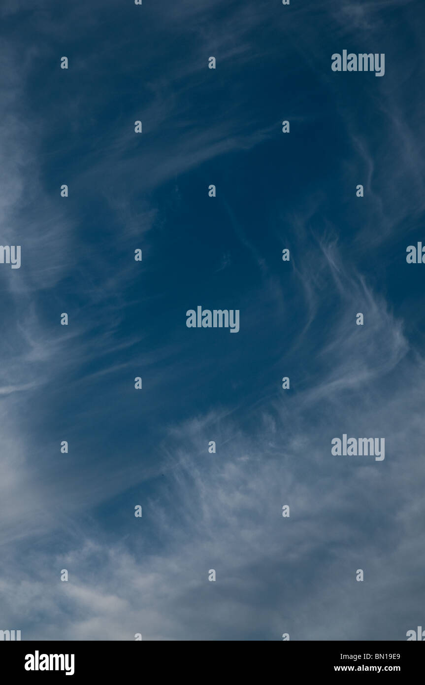 Blue sky with wispy clouds - Stock Image
