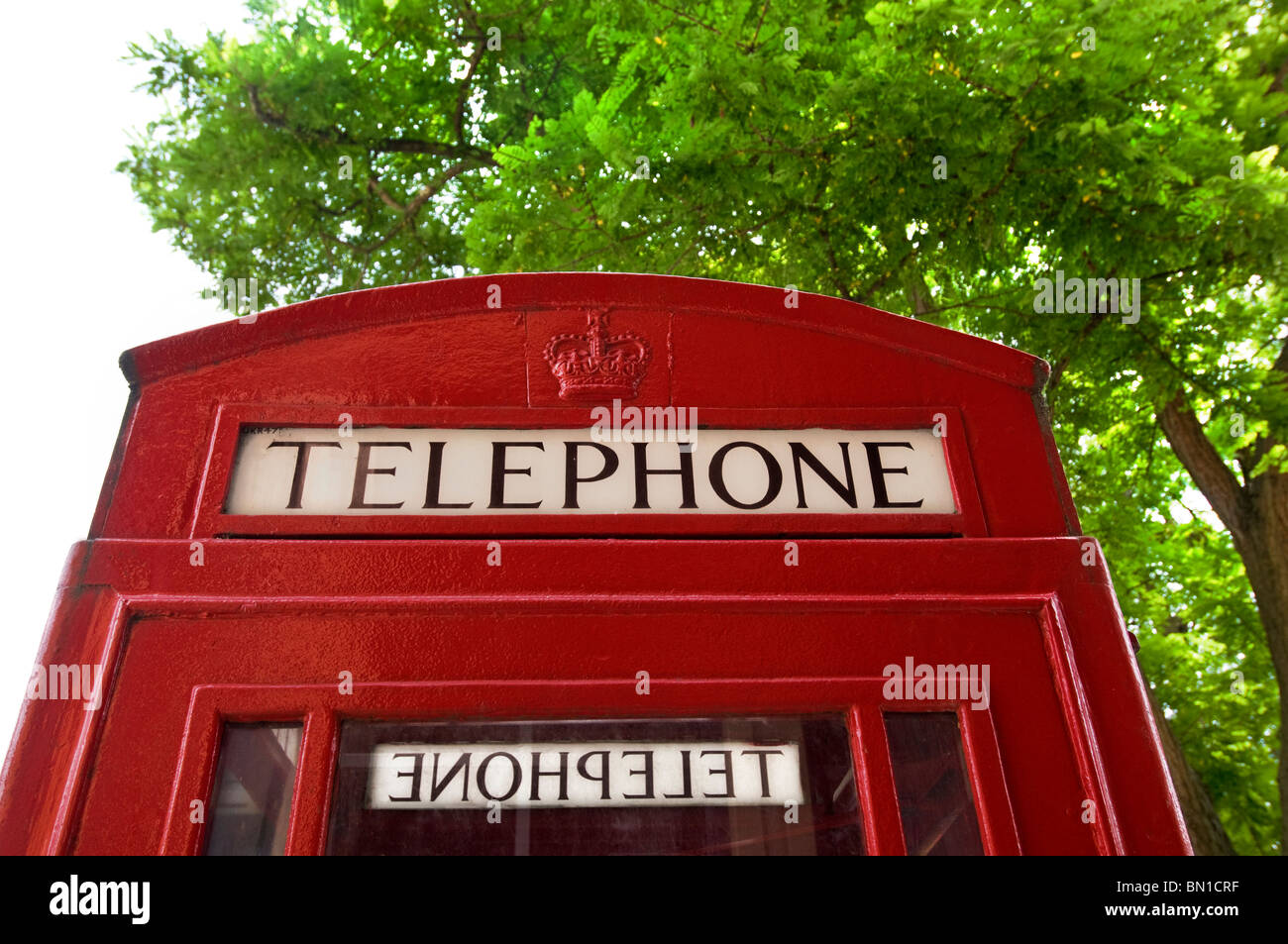 Traditional red British telephone box detail - Stock Image