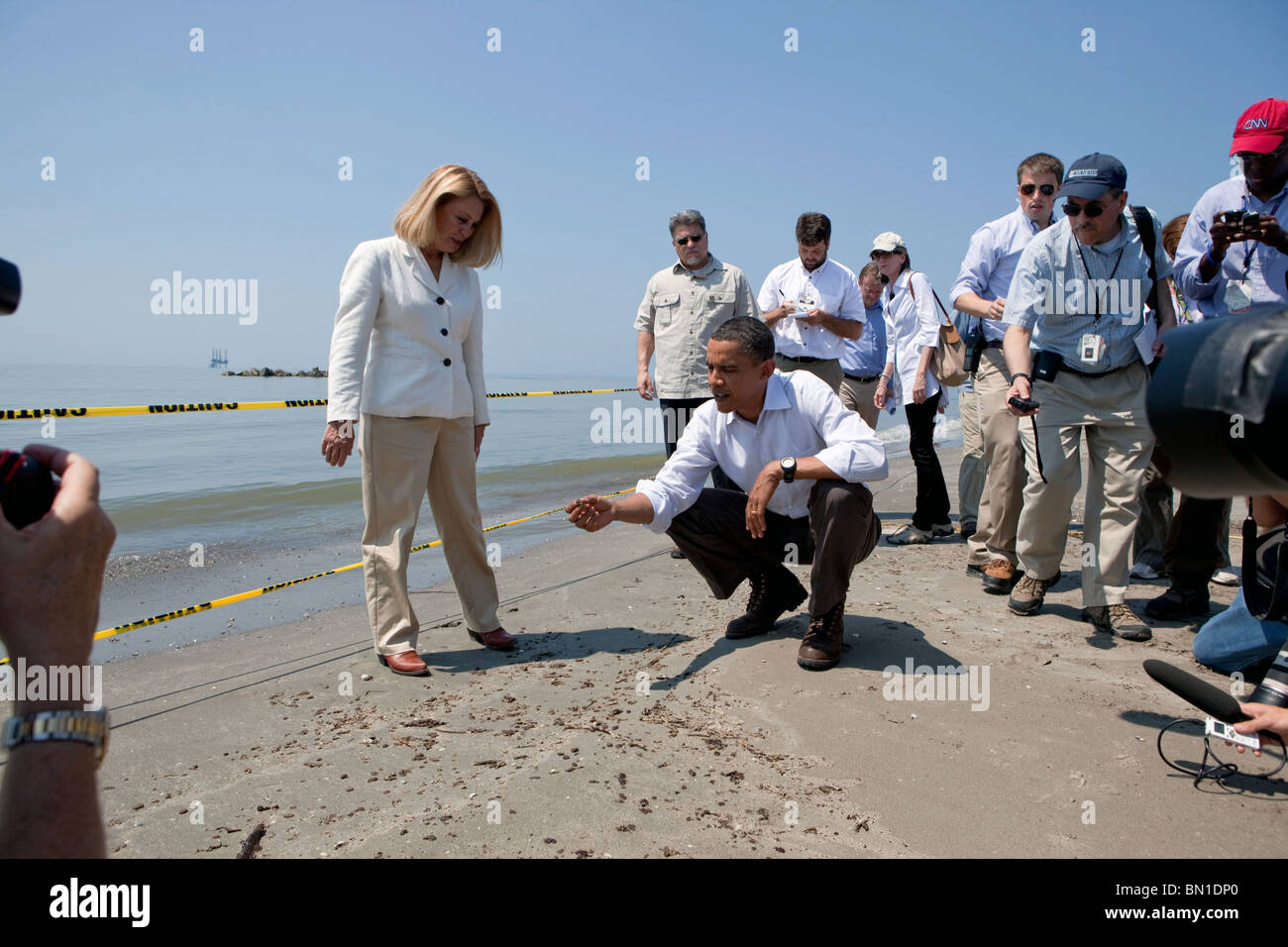 Barack Obama and Lafourche Parish President Charlotte Randolf, left, inspect a tar ball during the BP oil spill - Stock Image