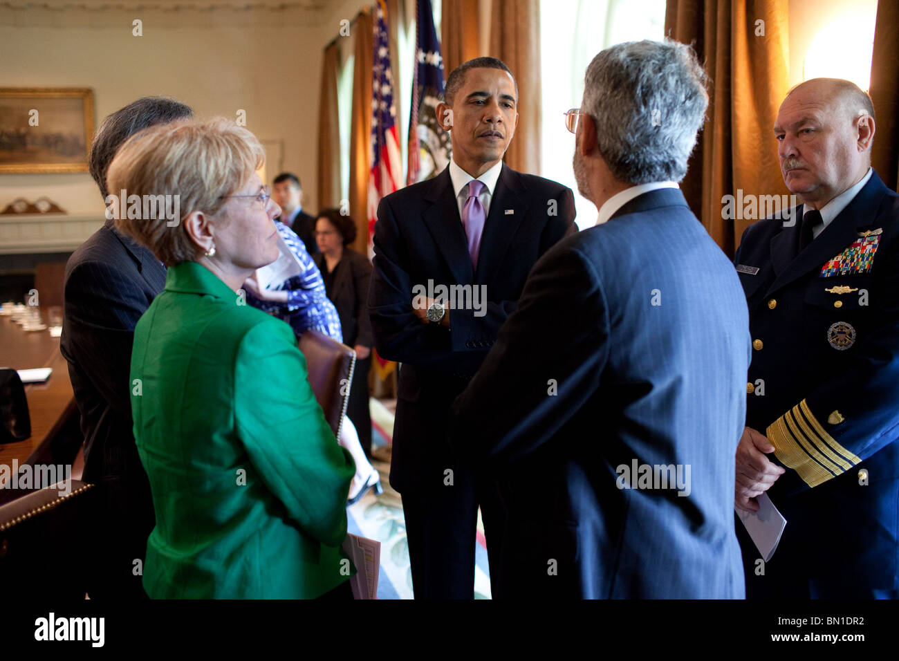 President  Obama talks with cabinet members - Stock Image