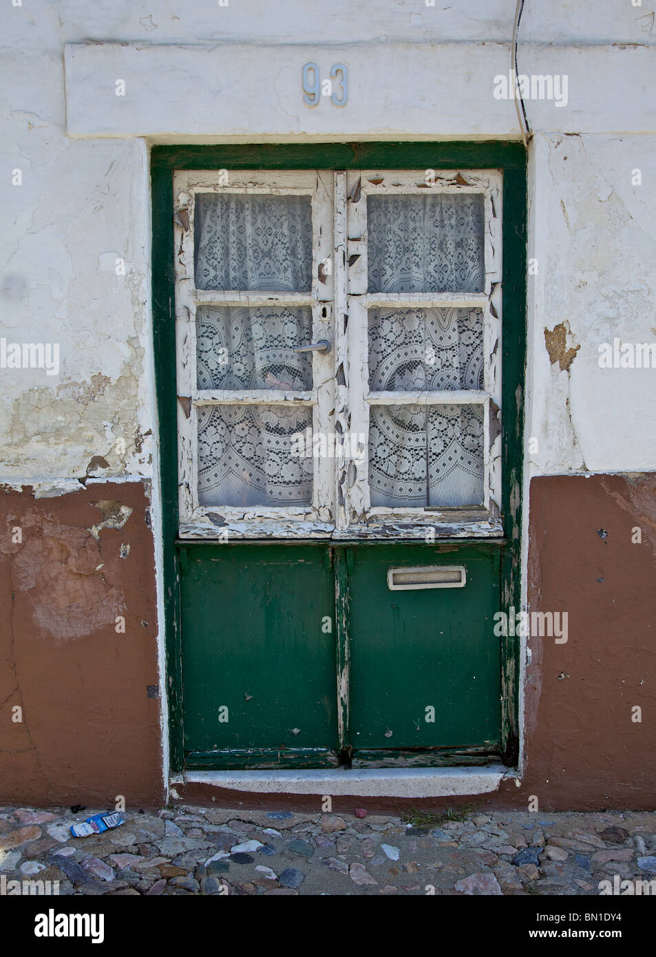 Green Rustic Faded Wood Door With Glass Window Of Old World ...