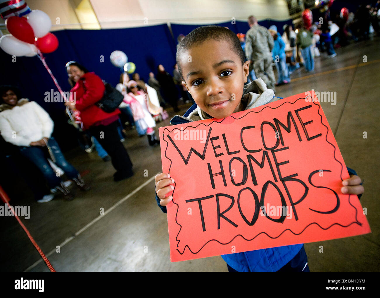 John Parker Jr. displays a sign celebrating his father's return March 1 at Misawa Air Base, Japan. - Stock Image
