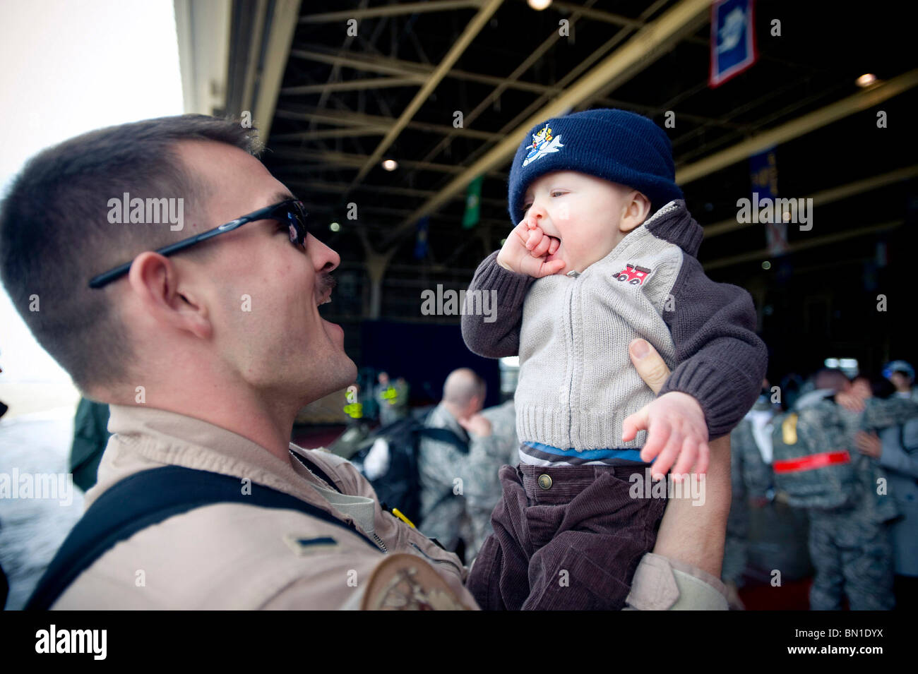 1st Lt. Ryan Cross holds his son March 1 at Misawa Air Base, Japan. - Stock Image
