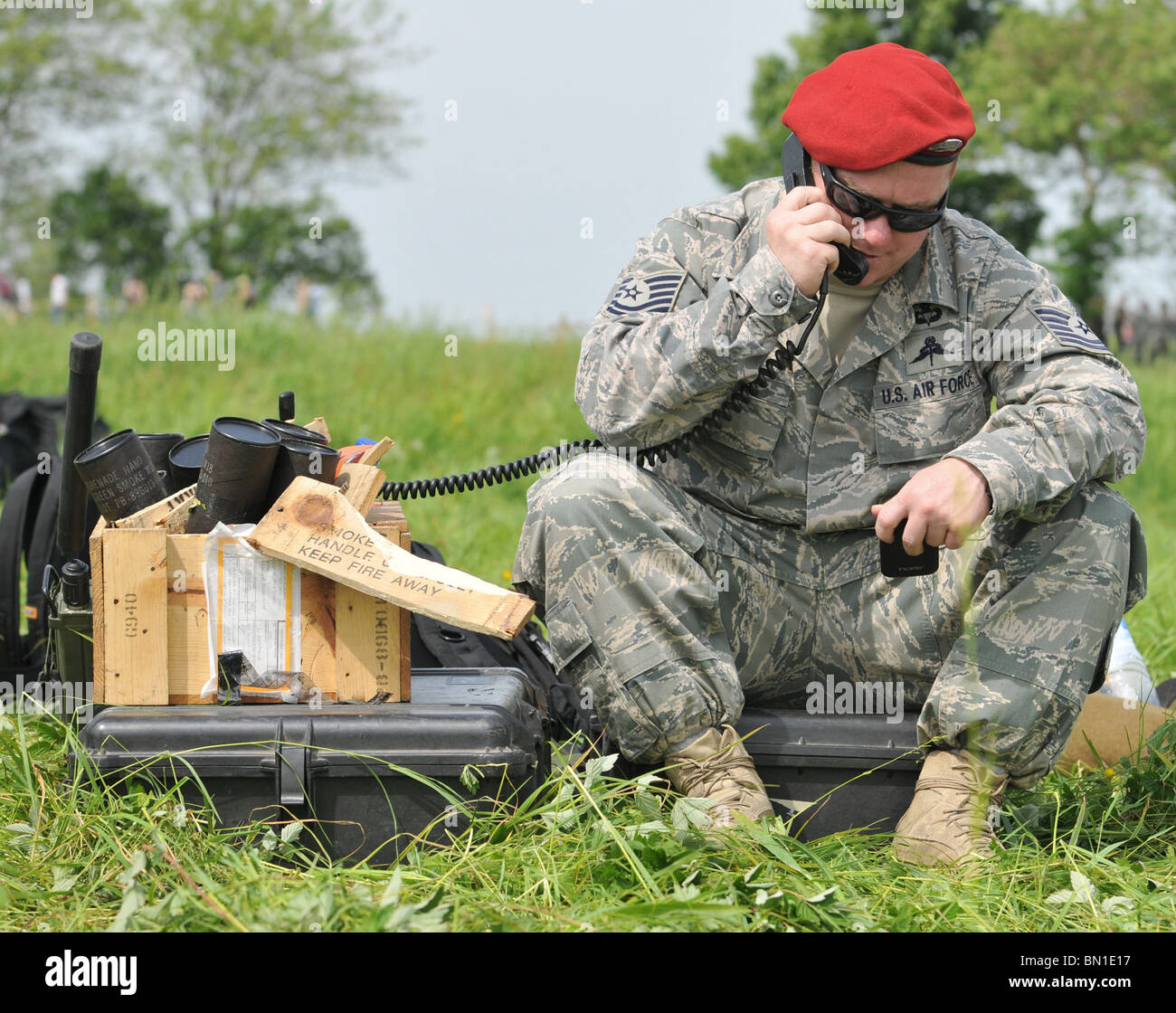 A member of the 321st Special Tactics Squadron relays wind direction and other pertinent information to aircraft - Stock Image