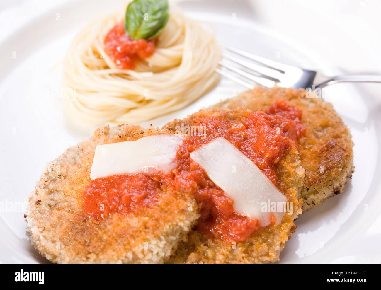 Vegan Eggplant Parmesan with Angel Hair Pasta and Marinara Sauce Stock Photo