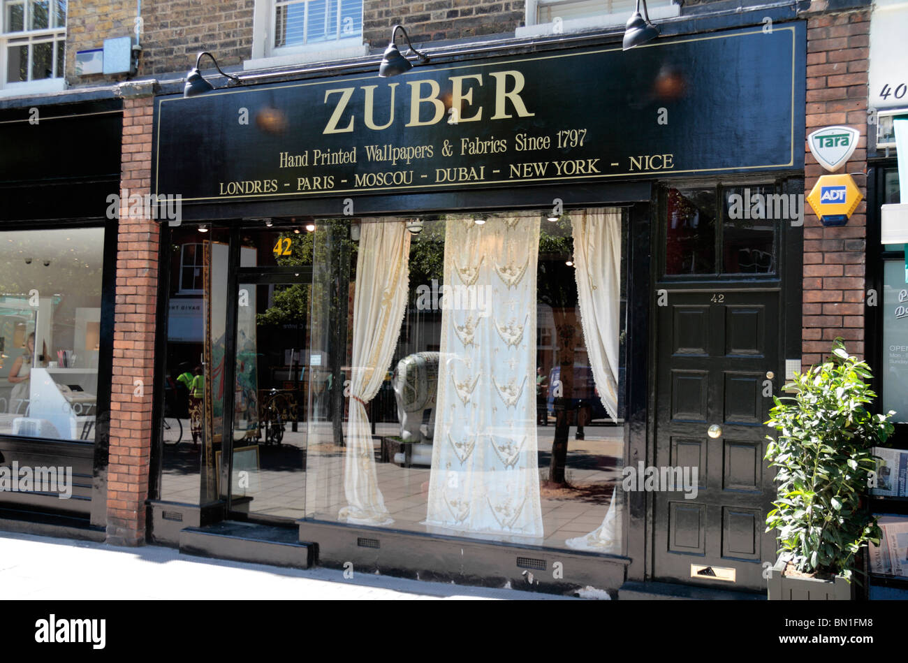 The shop front of the Zuber Wallpaper and fabrics shop, 42 Pimlico Road, London