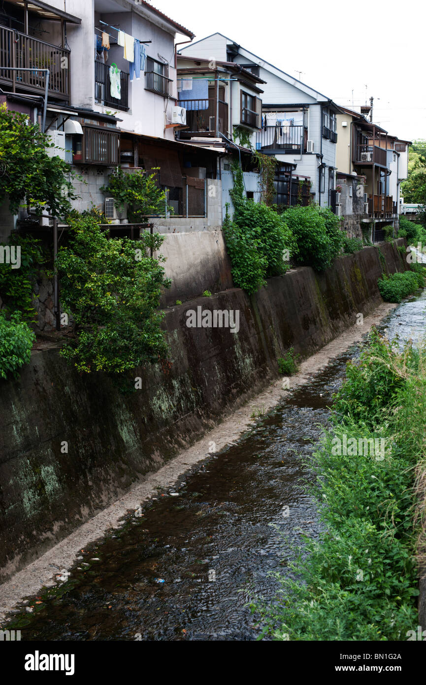 A row of houses along a straight river near Daitoku-ji in Kyoto. - Stock Image