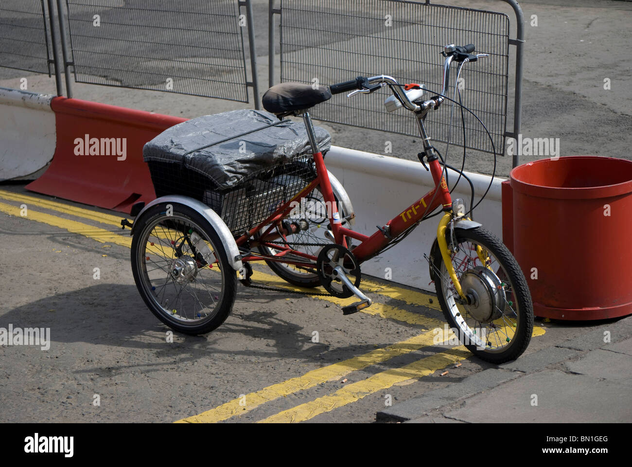 Battery-powered tricycle parked in the centre of Edinburgh, Scotland. - Stock Image