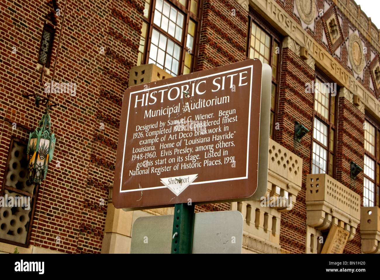 Historic site sign in front of the stunning brick art deco design