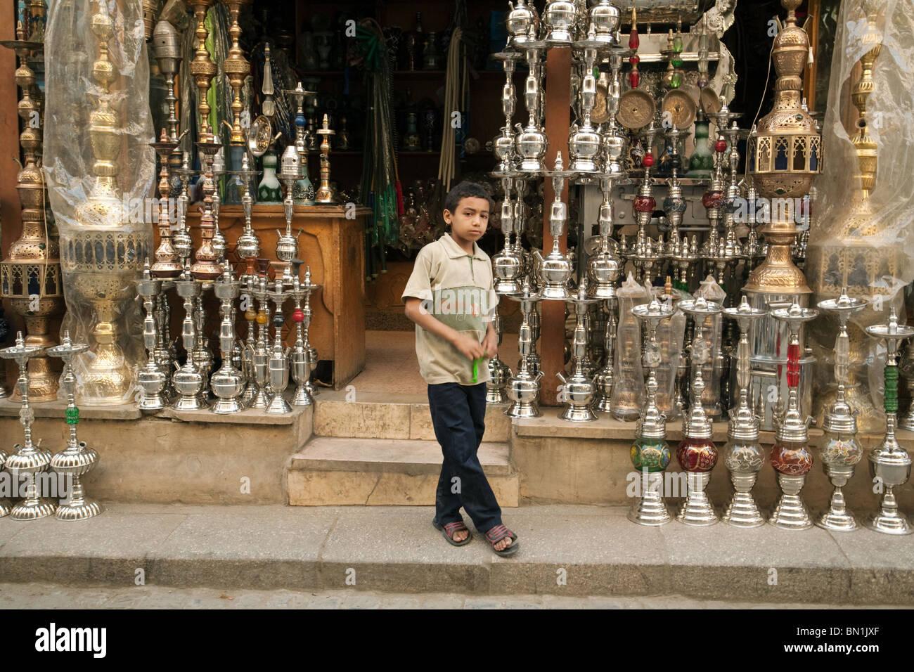 Shop and child shopkeeper in the Khan al khalili market, Islamic quarter, Cairo Egypt - Stock Image