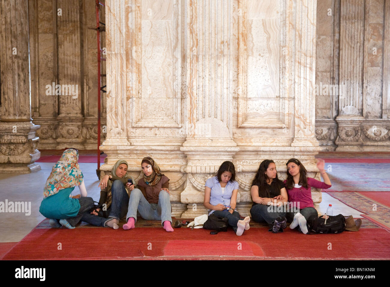 A group of  muslim egyptian teenage girls sitting inside the Mosque of Muhammad Ali Pasha, The Citadel, Cairo, Egypt - Stock Image