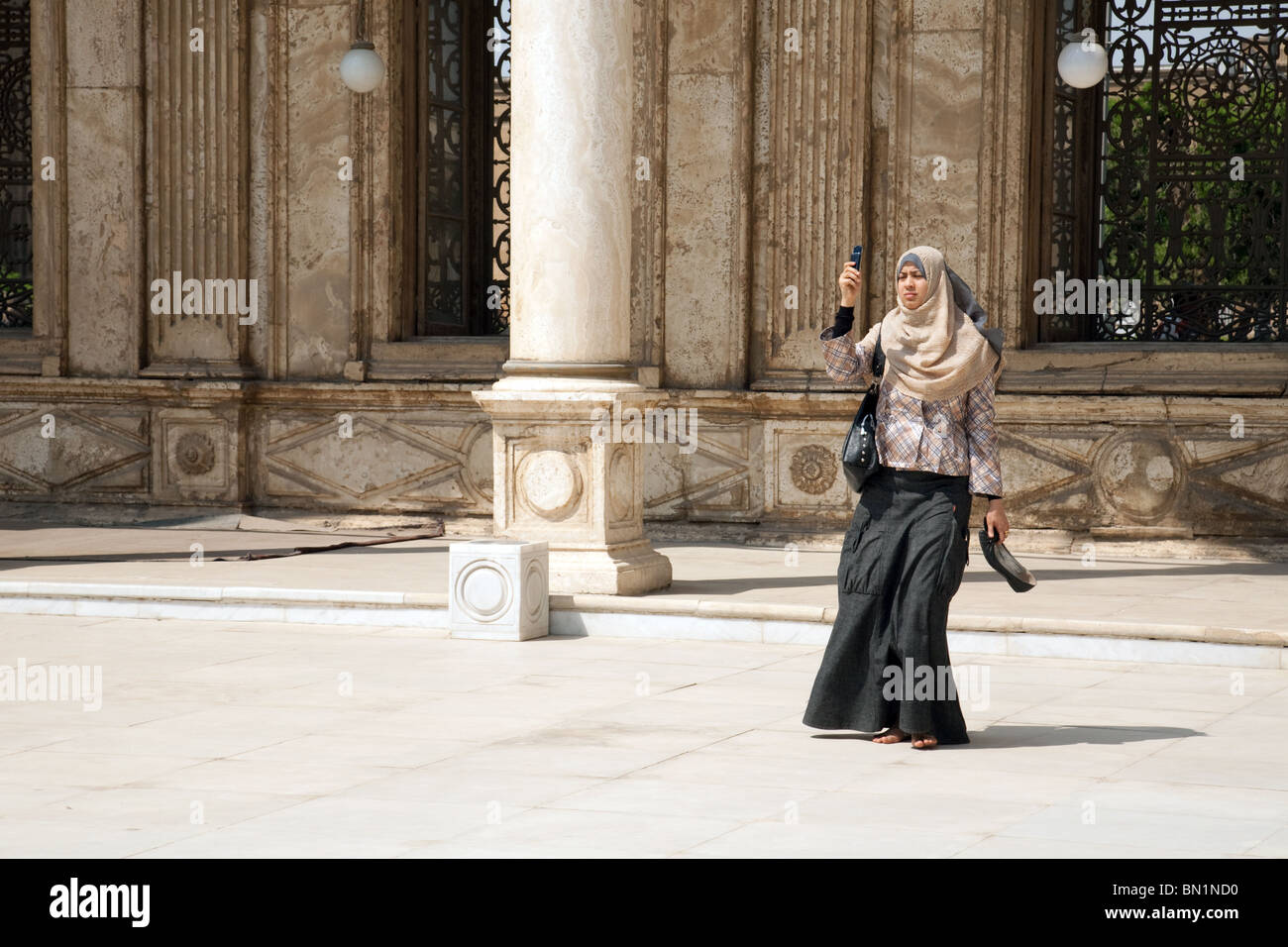 Moslem woman taking a photograph, Muhammad Ali Mosque, Cairo, Egypt - Stock Image