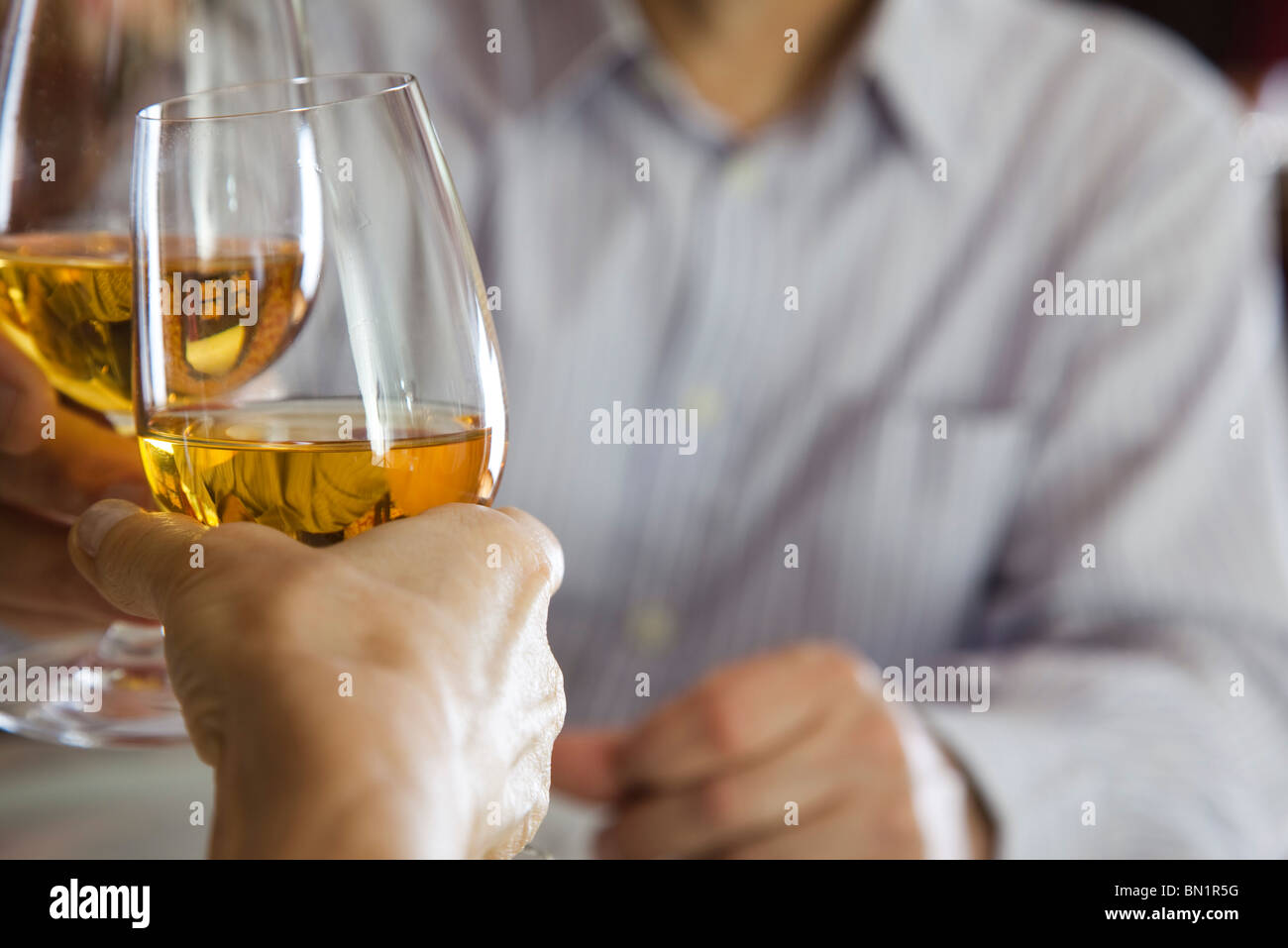 Clinking glasses - Stock Image