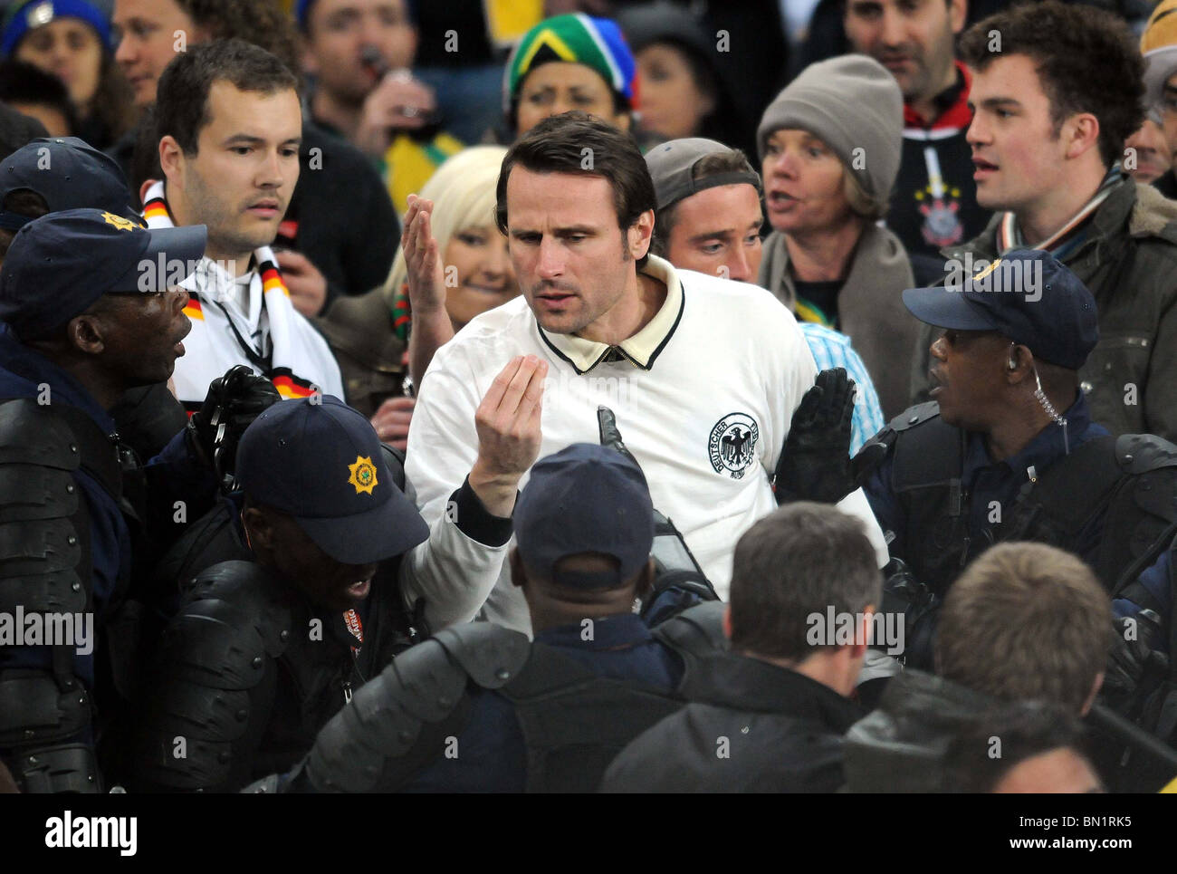 GERMAN FAN CLASHES WITH SOUTH GHANA V GERMANY SOCCER CITY  SOUTH AFRICA 23 June 2010 - Stock Image