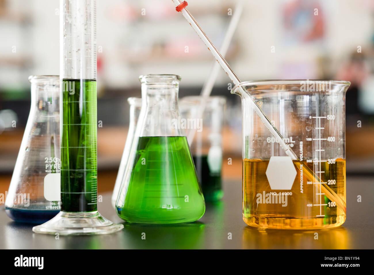 Chemicals in beakers - Stock Image